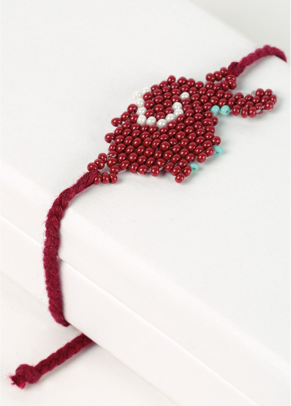 Thread bracelet with beads